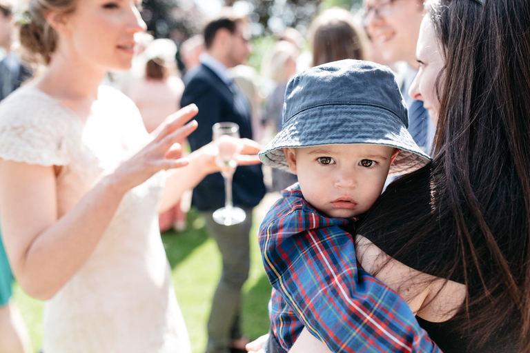 toddler in a sun hat
