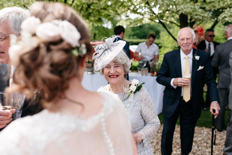 bride's grandparents smiling at the bride