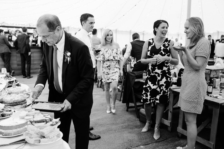 father of the bride cutting cake