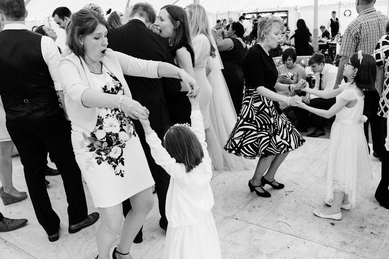 ladies dancing with kids on the dance floor