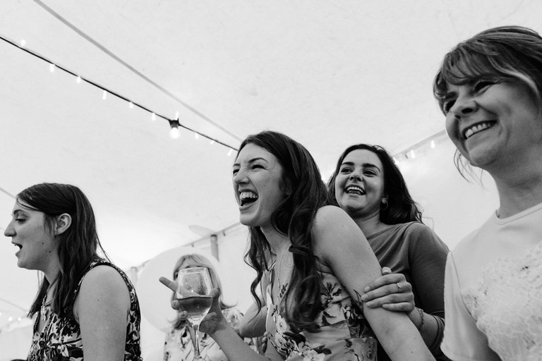 female wedding guests laughing on the dance floor