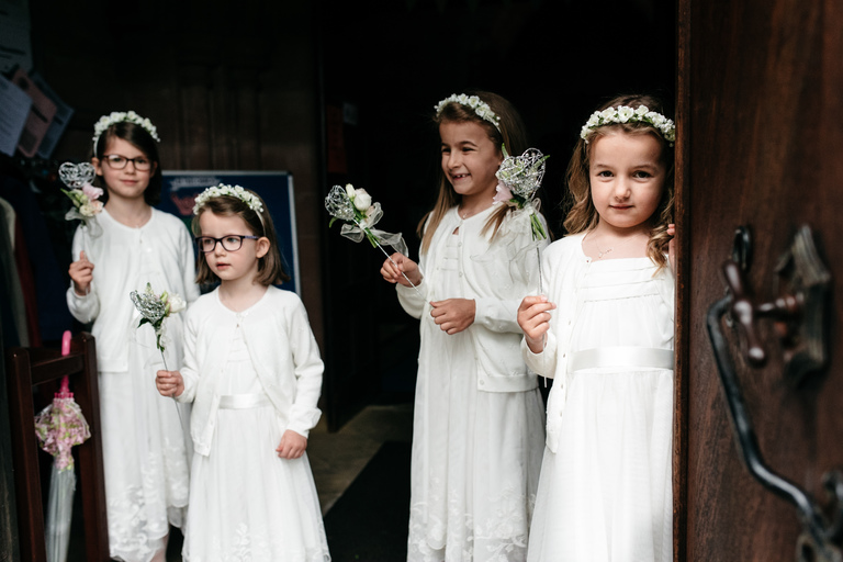 flower girls waiting at the church door
