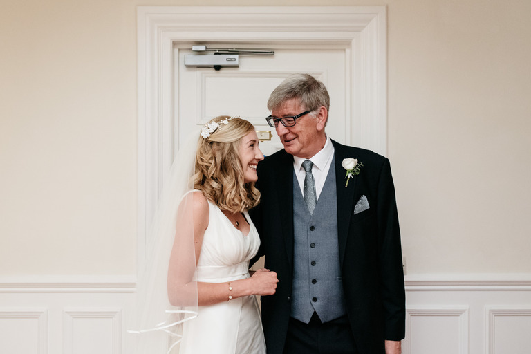 bride with her dad before the wedding
