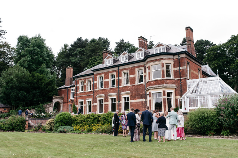 guests on the lawn to the rear of nanpantan hall