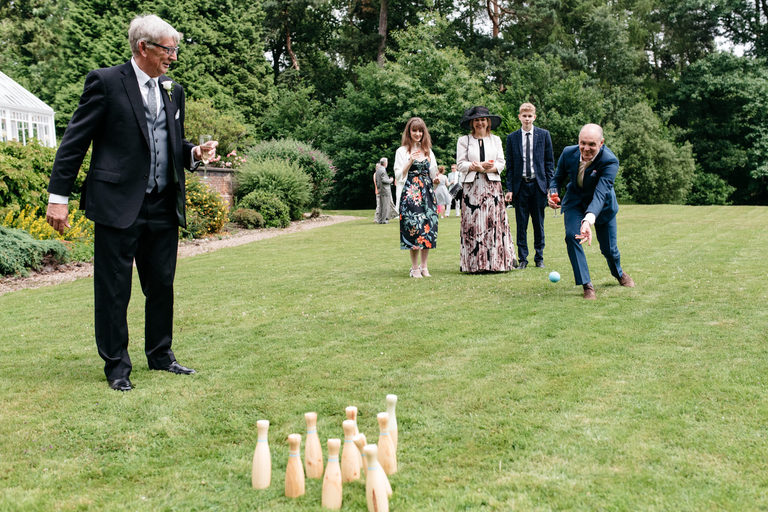 playing skittles on the lawn