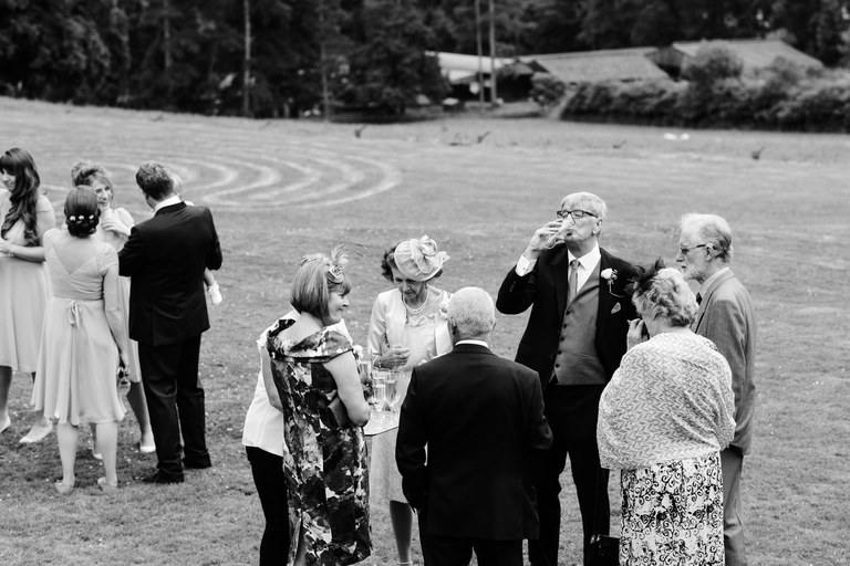 father of the bride finishing his drink