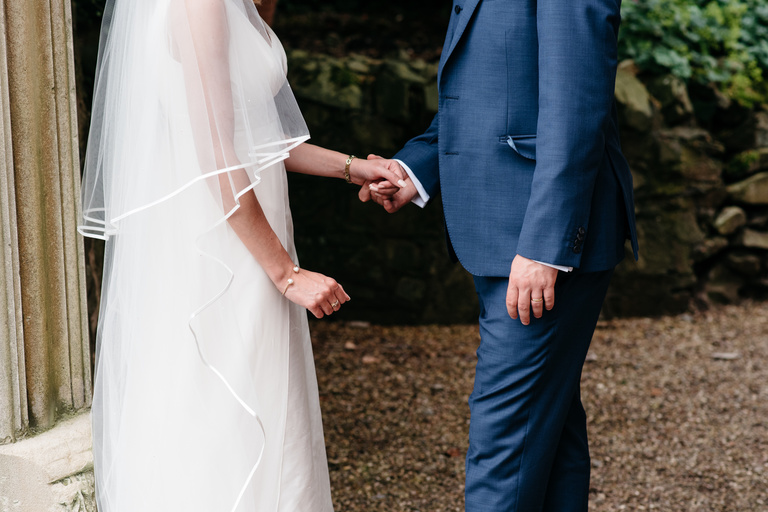close up portrait of newlyweds hands