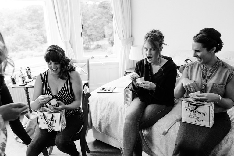 bridesmaids receive gifts from the bride