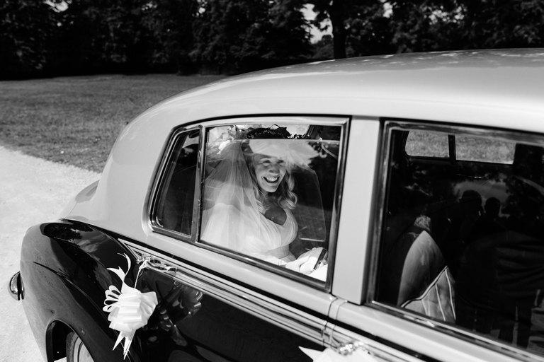 bride arriving at venue in wedding car