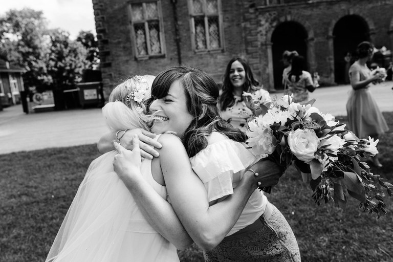 bride giving her friend a big hug