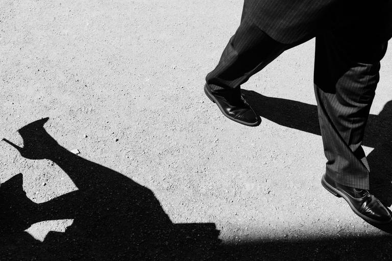 guests shadows at sunny wedding