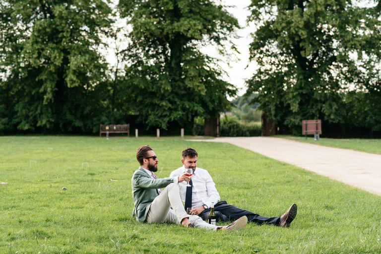 two guys relaxing on the grass