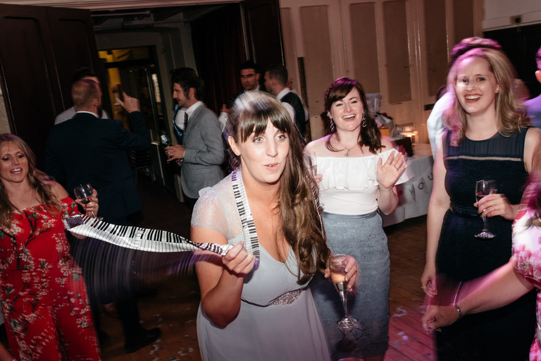 bridesmaid spinning a piano tie