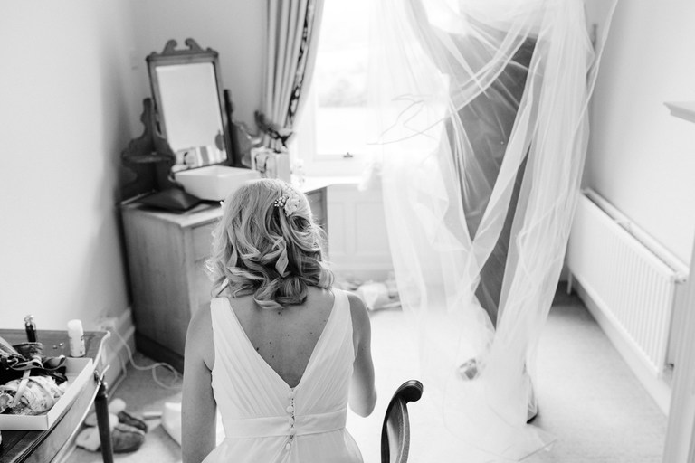 bride having her veil fitted