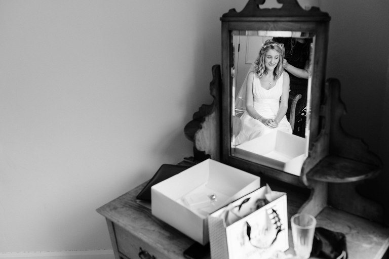 brides reflection in a mirror