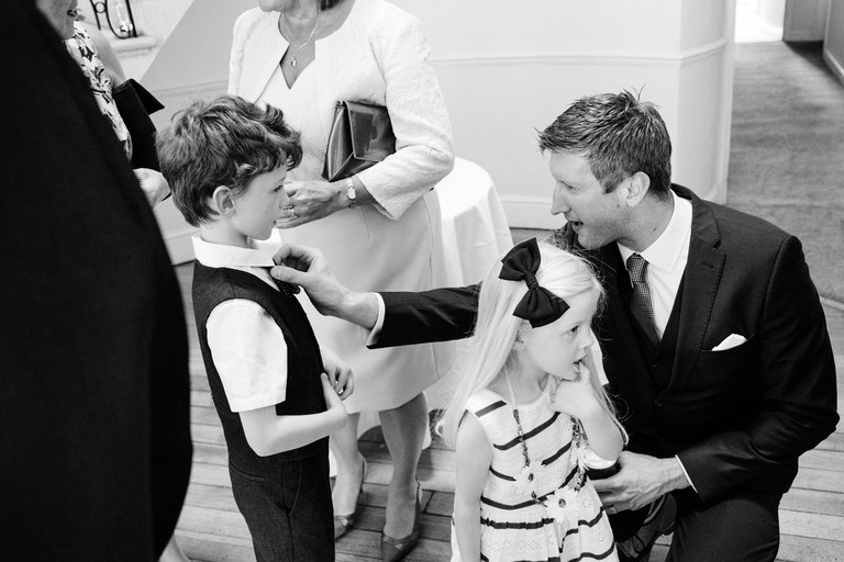 father straightens his sons tie