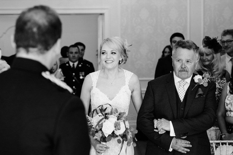 walking down the aisle with her father