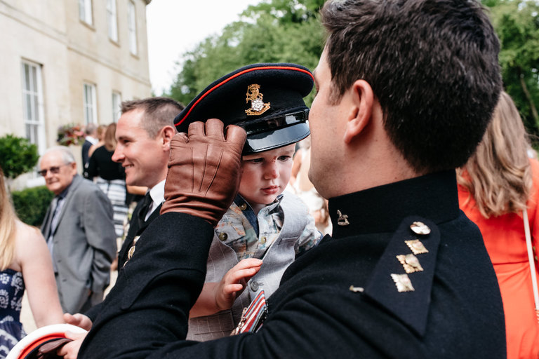 soldier lets his son wear his hat