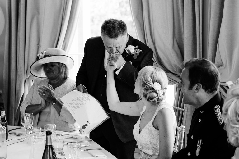 father of the bride kissing his daughters hand