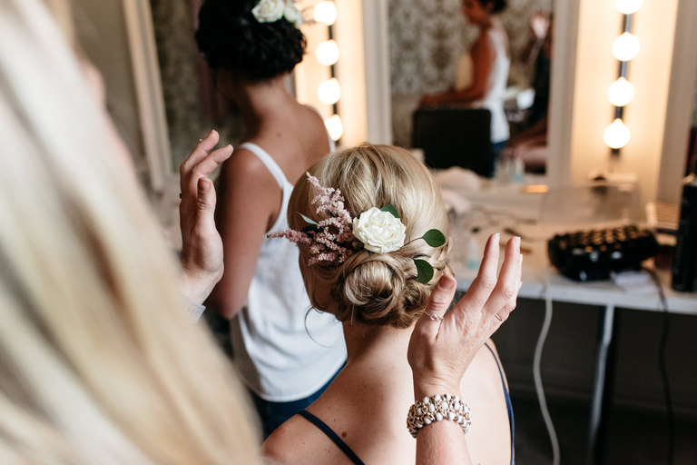 hair stylist admiring brides hair