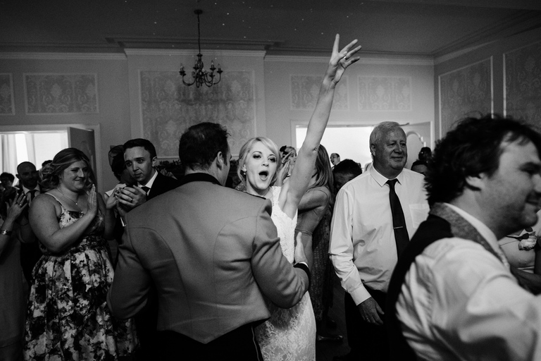 bride cheering on the dance floor