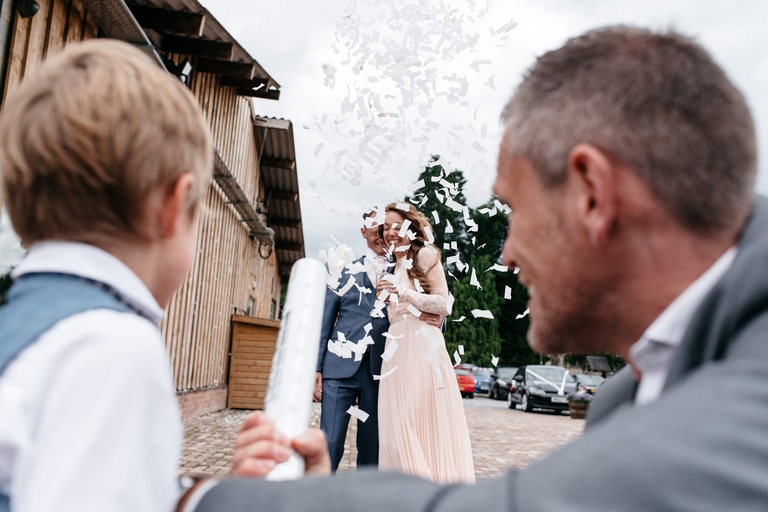 couple showered by confetti cannon