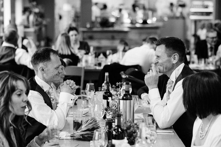 groom sitting opposite best man