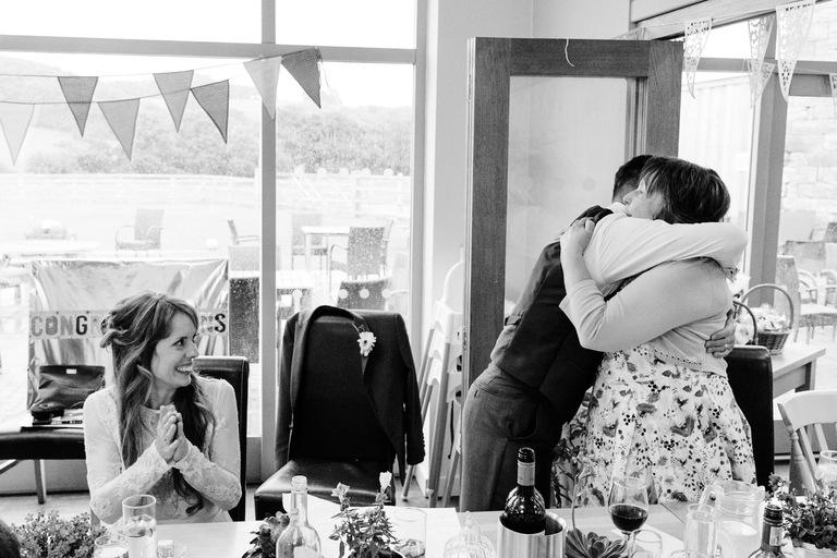 groom hugs mother in law