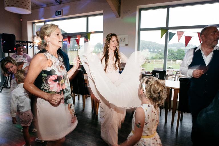 bride swinging her dress on the dance floor