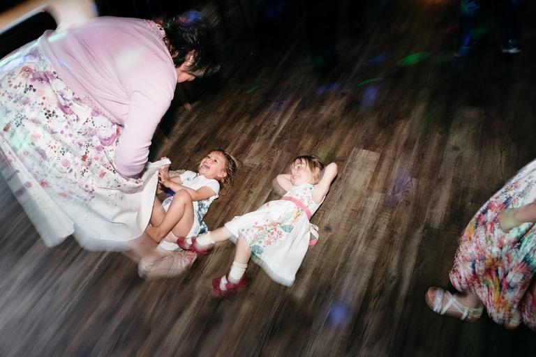 little girls playing on dancefloor