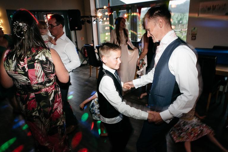 groom dancing with boy