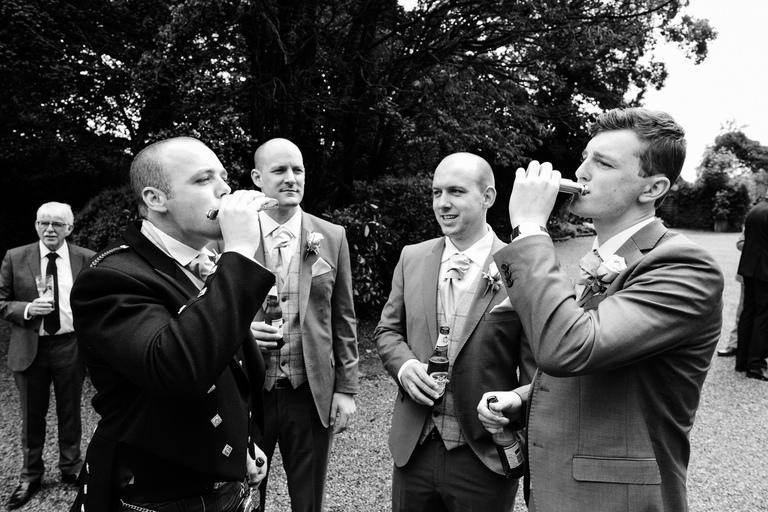 groom having a swig of dutch courage