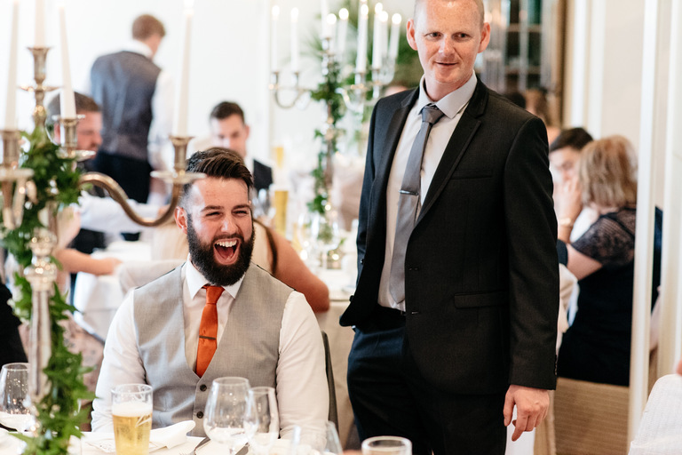 laughing bearded wedding guest
