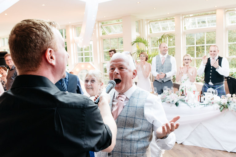 singing waiter gets dad to join in