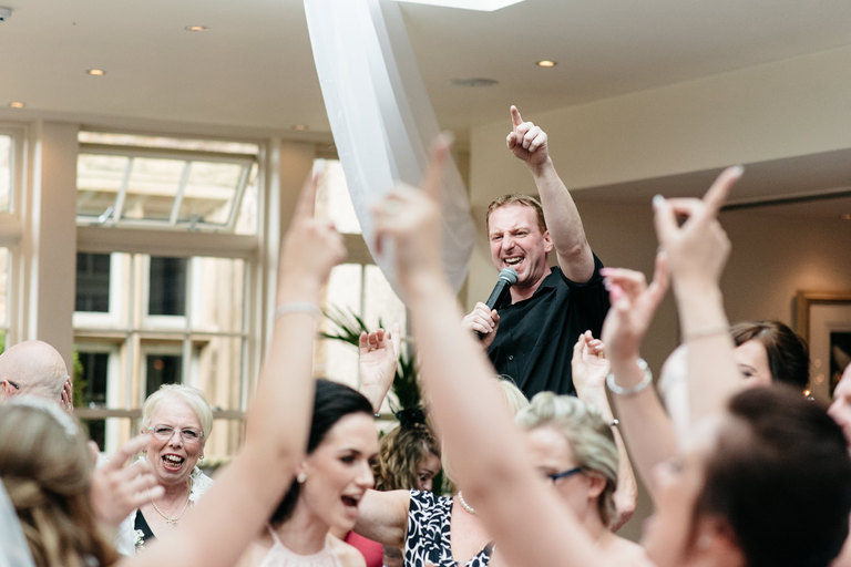 singing waiter working the crowd