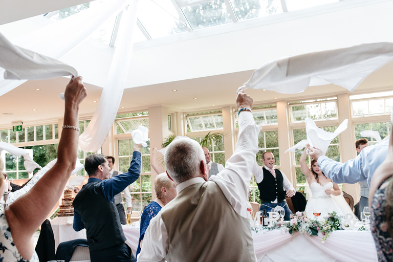 waving napkins during wedding breakfast