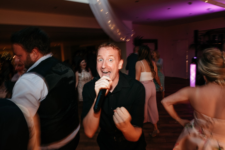 singing waiter after first dance