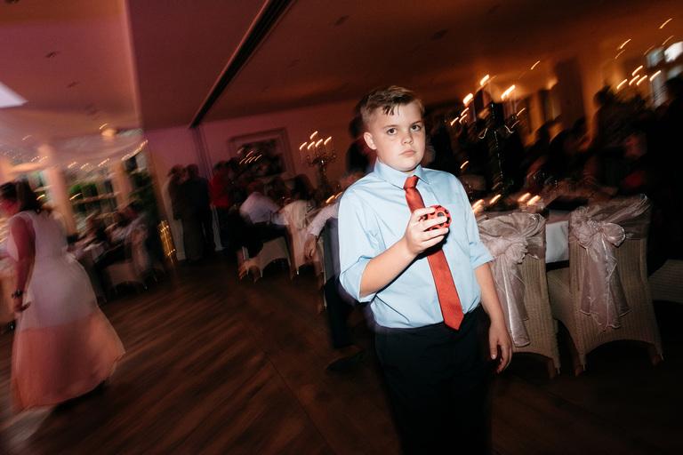 boy looking lost on the dance floor