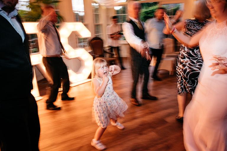 little girl enjoying the dancing