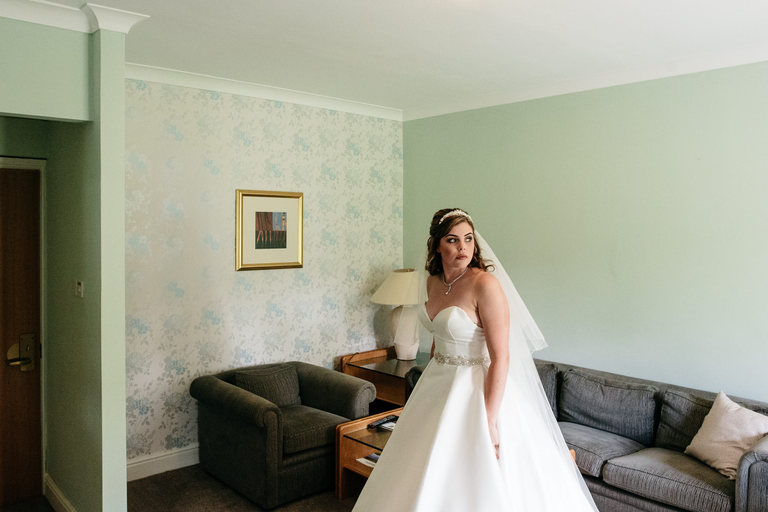 nervous bride waiting to leave the hotel