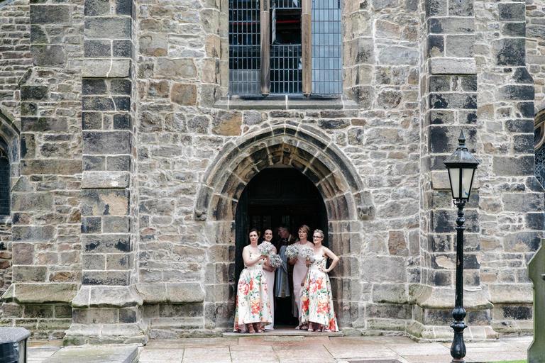 bridesmaids waiting at the church doors