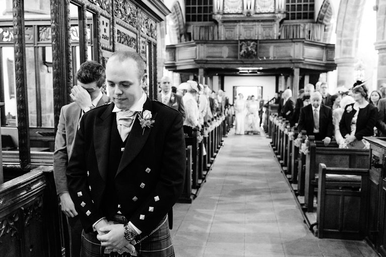 nervous groom waiting at the altar