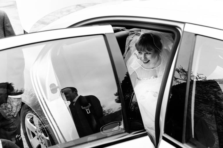 bride getting out wedding car