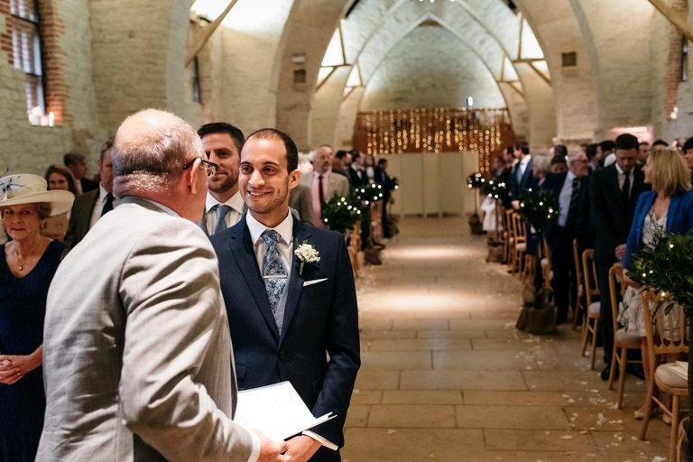 groom waiting at tithe barn