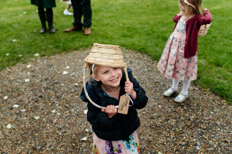 flower girl with basket on her head