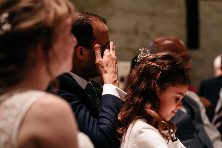 groom wiping his eyes