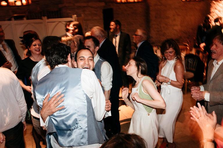 groom hugging on dance floor