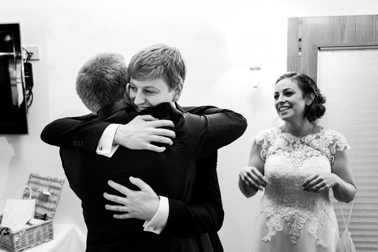 groom giving hugs