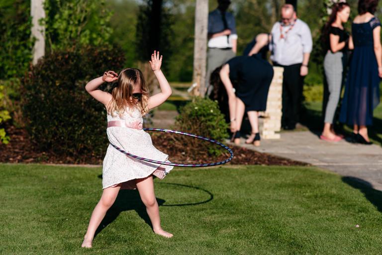 girl playing with hula hoop
