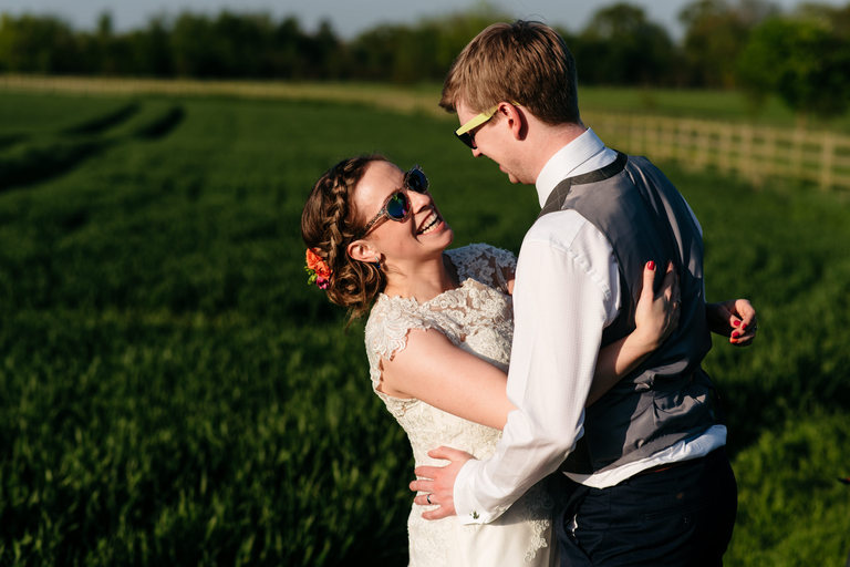 relaxed sunny wedding portraits with sunglasses